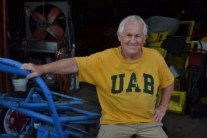 T.C. CANNON POSES WITH SOME OF HIS FAVORITE VEHICLES WHILE SPORTING HIS SIGNATURE UAB SHIRTS. PHOTO BY JULIANNA HUNTER.