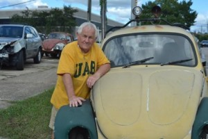 T.C. CANNON POSES WITH SOME OF HIS FAVORITE VEHICLES WHILE SPORTING HIS SIGNATURE UAB SHIRTS. PHOTO BY JULIANNA HUNTER